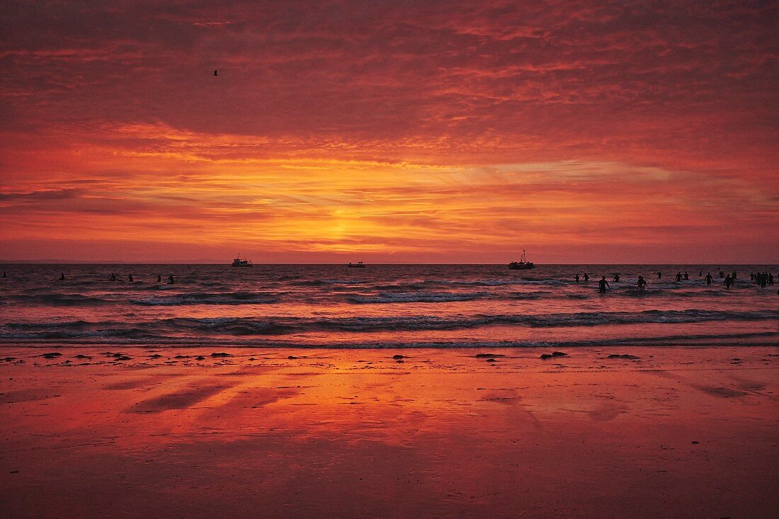 Swimmers in the sea at dawn in Tenby (Wales, Great Britain)
