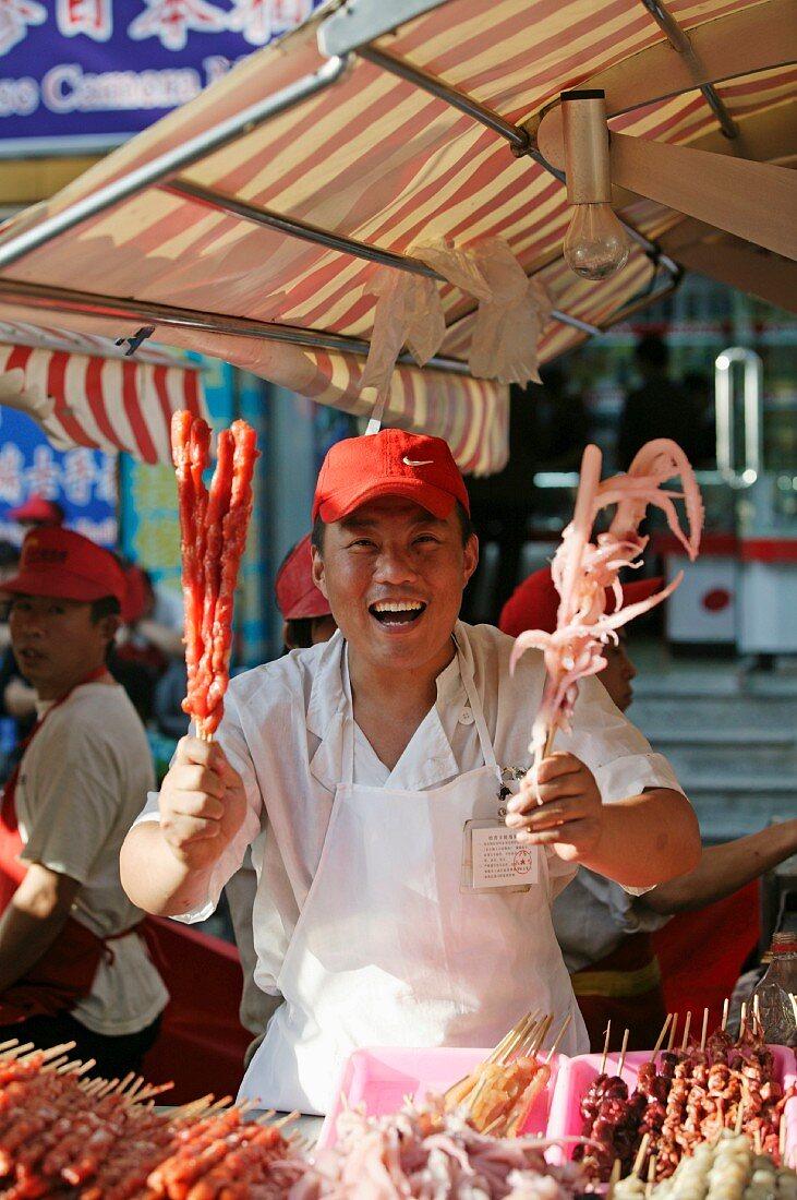 Chinese street food in the Wangfujing Dajie shopping district, Beijing, China, Asia