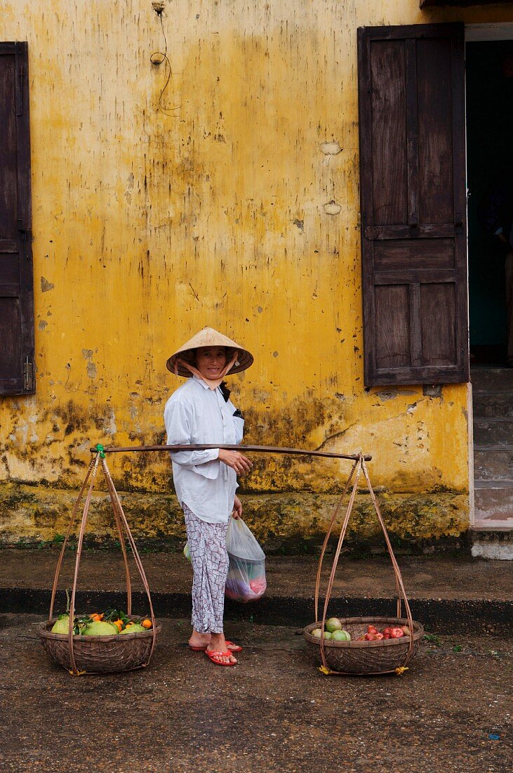 A fruit seller in Hoi An, Vietnam, Indochina, South-East Asia
