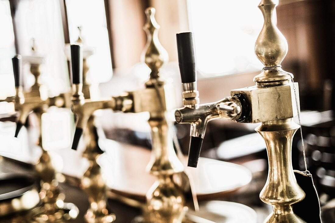 Old fashioned taps in the traditional pub Anno 1905 in Hamburg