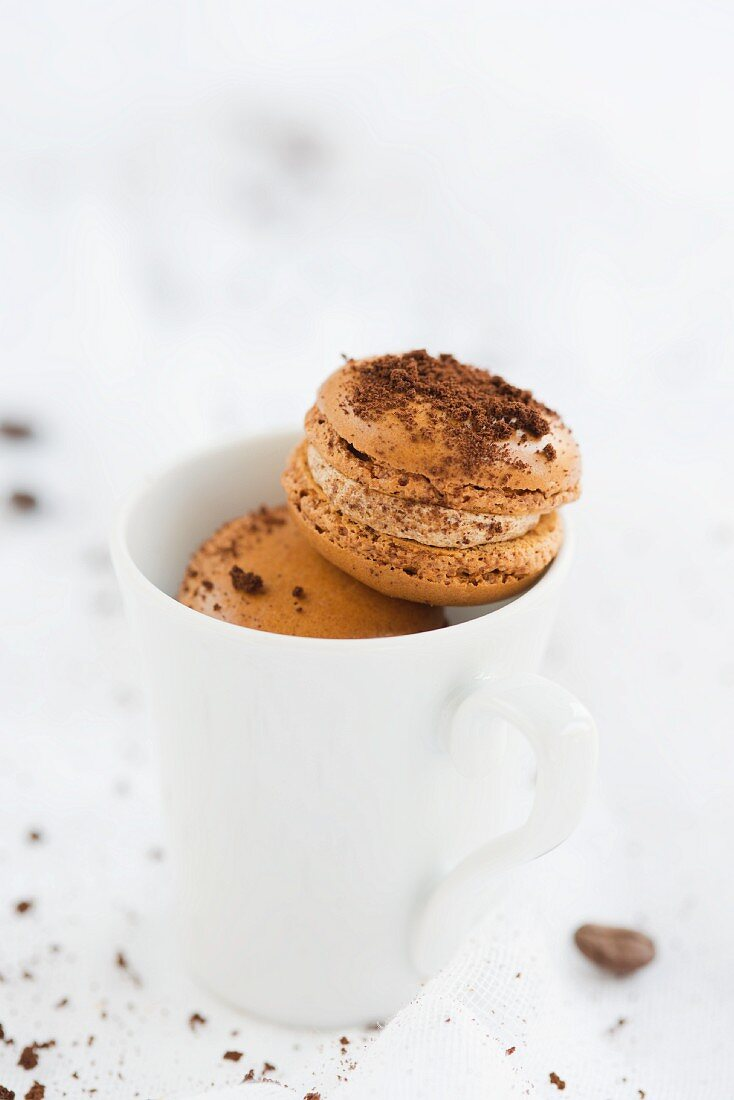 Coffee macaroons in a cup