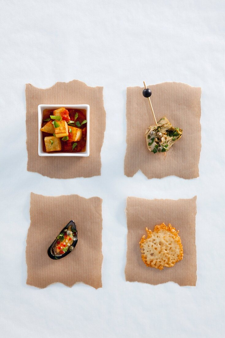 Patatas bravas, artichokes, mussels and a cheese cracker