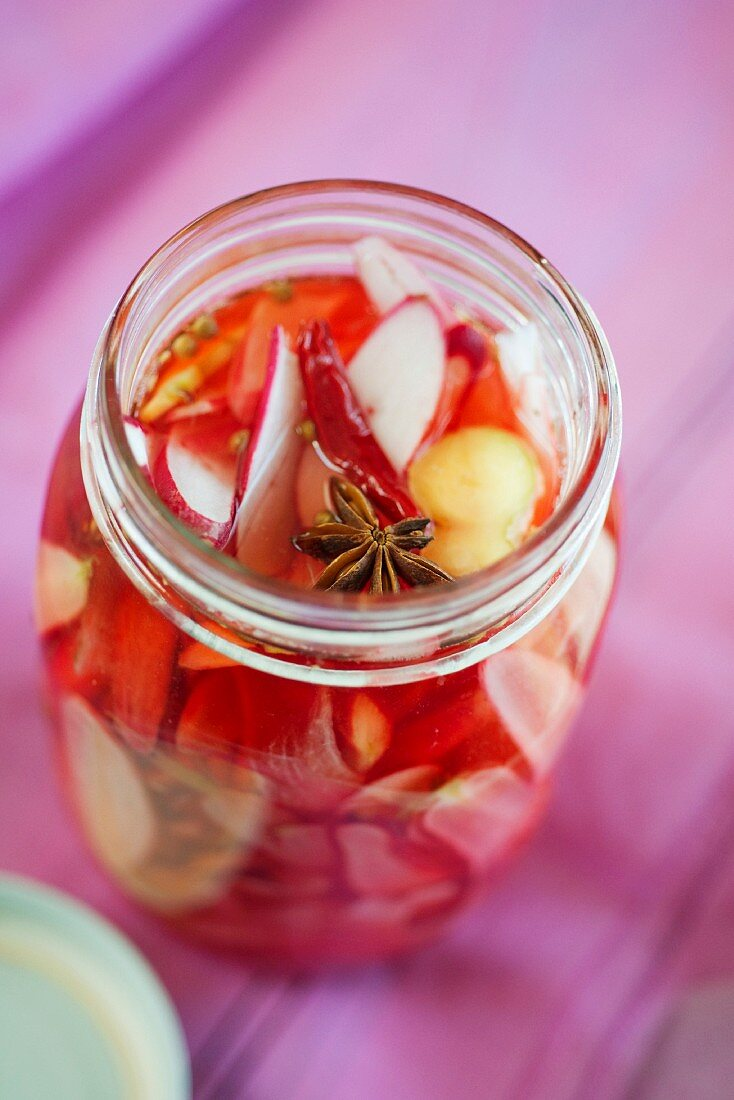 Pickled radishes with star anise and ginger roots