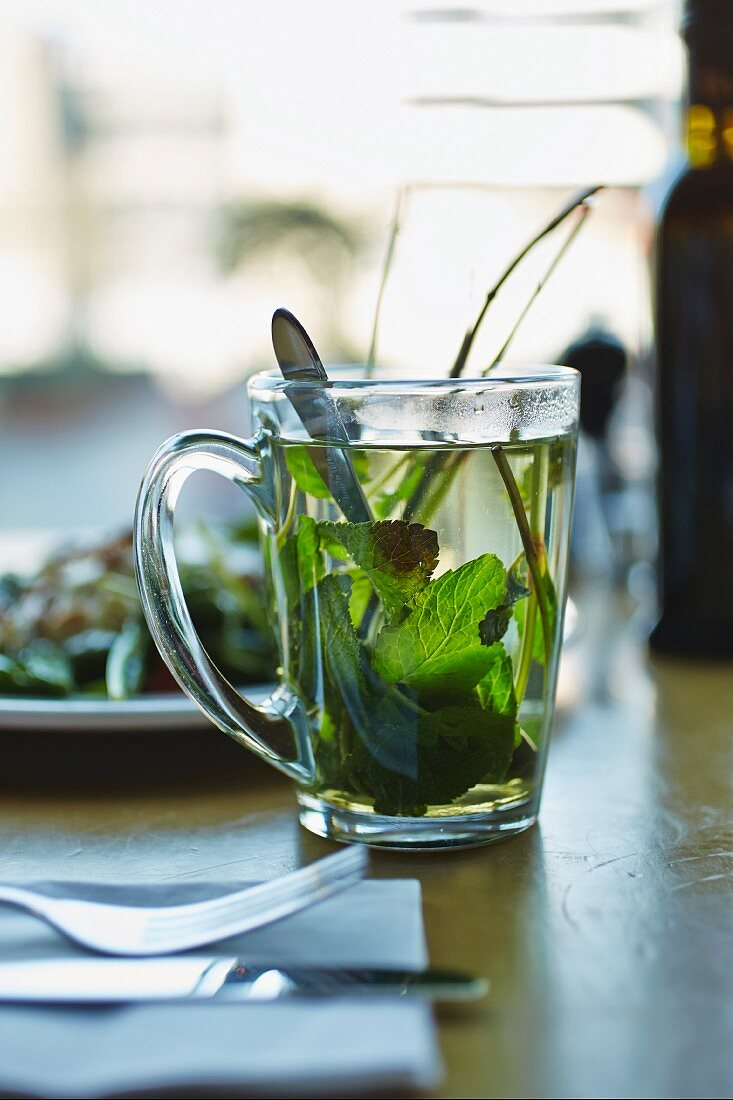Peppermint tea in a glass cup