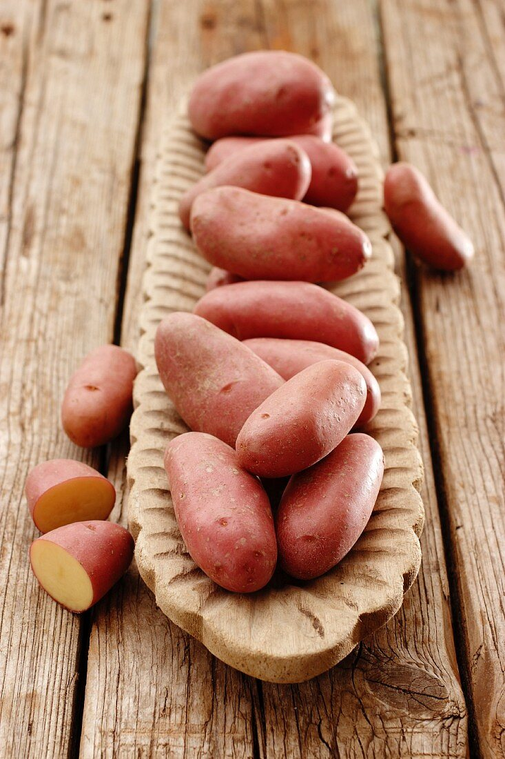 Red-skinned 'Cherie' potatoes in a wooden dish