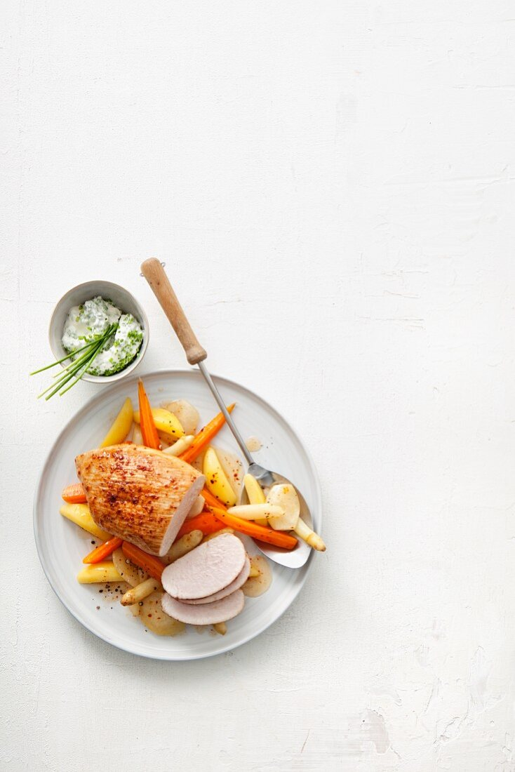 Roast turkey breast with vegetables served with a chive dip
