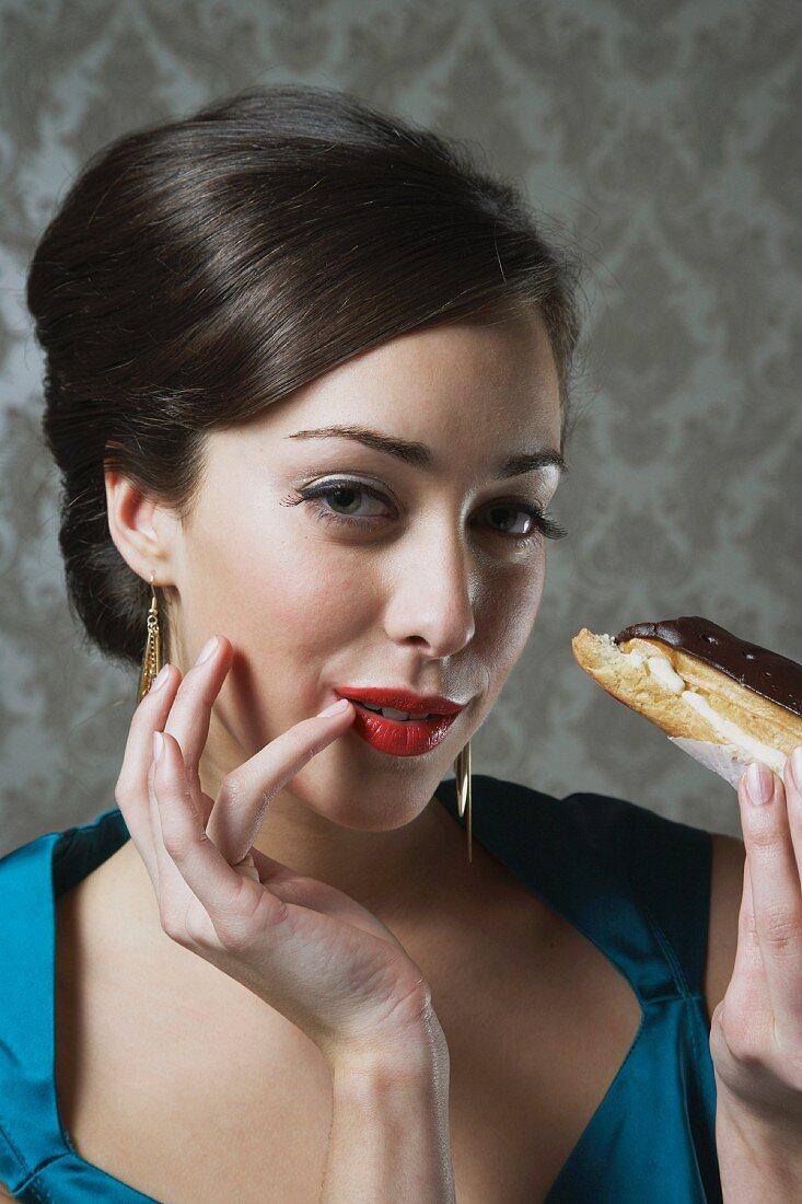 A woman eating an eclair