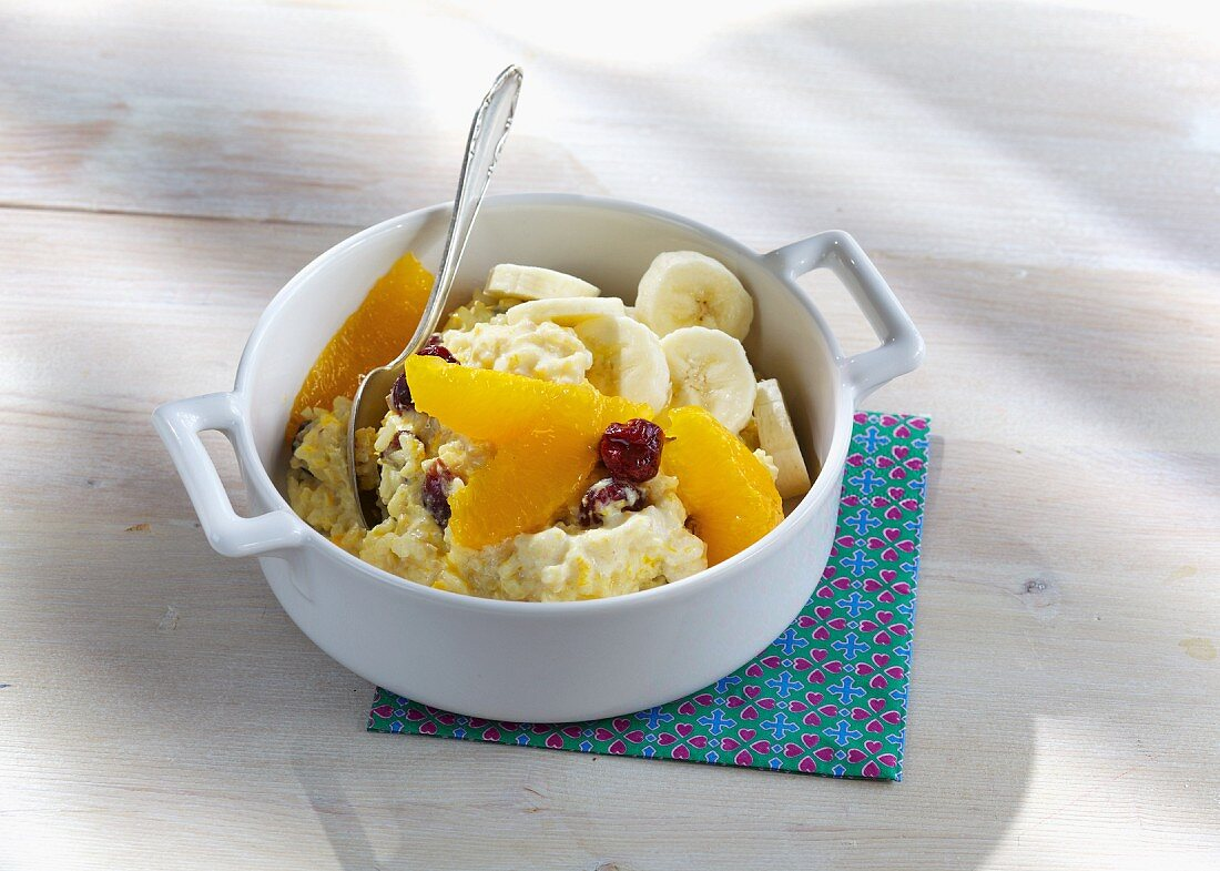 Orange rice pudding with dried cranberries