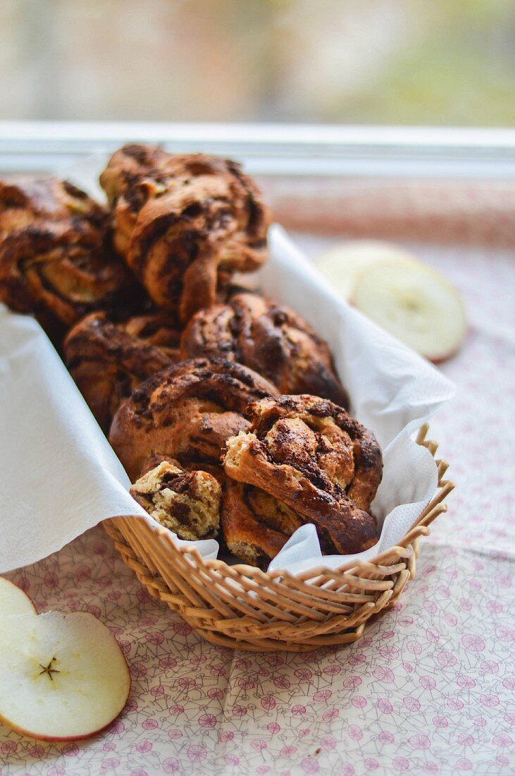 Almond and apple cakes with chocolate in a bread basket