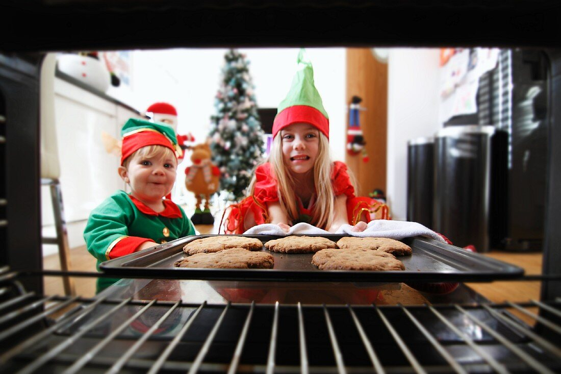 Two children baking Christmas biscuits