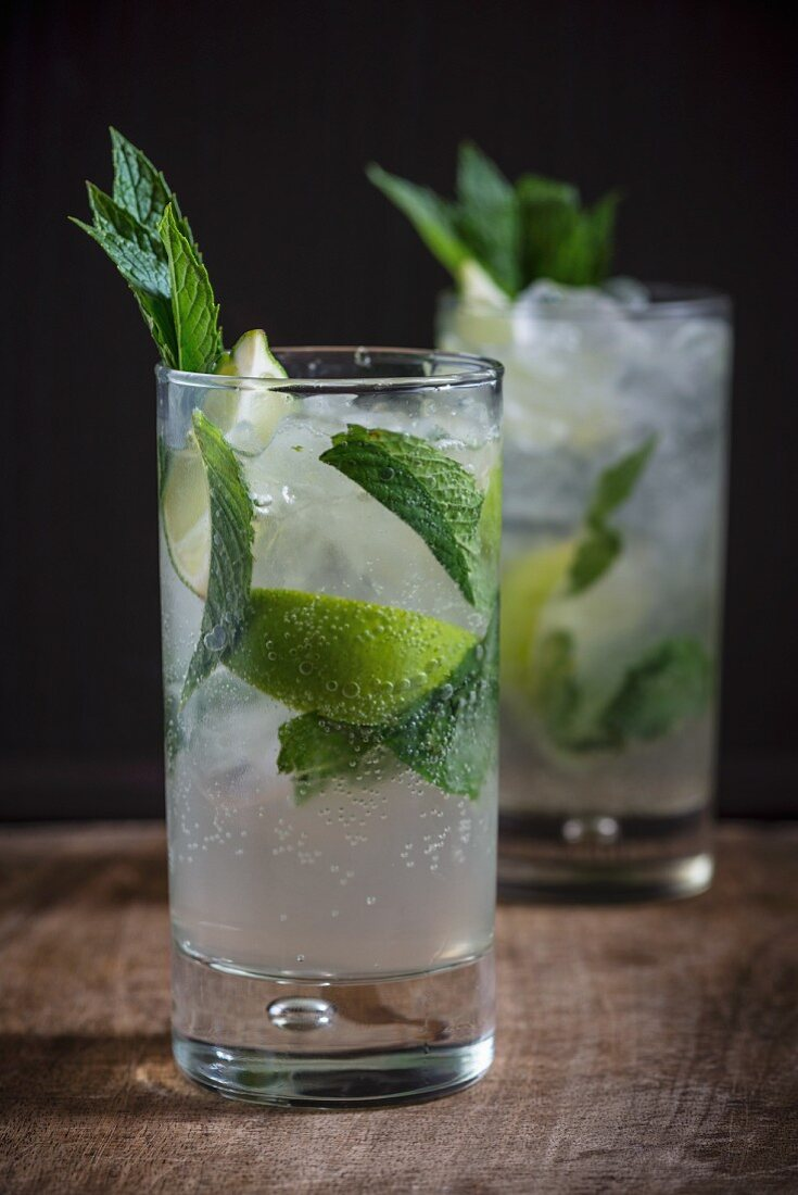 Homemade lemonade with ice, limes and peppermint