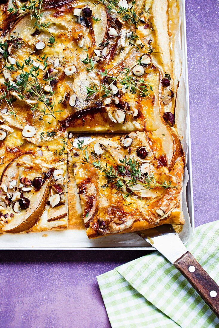 Pear and cheese tart, sliced