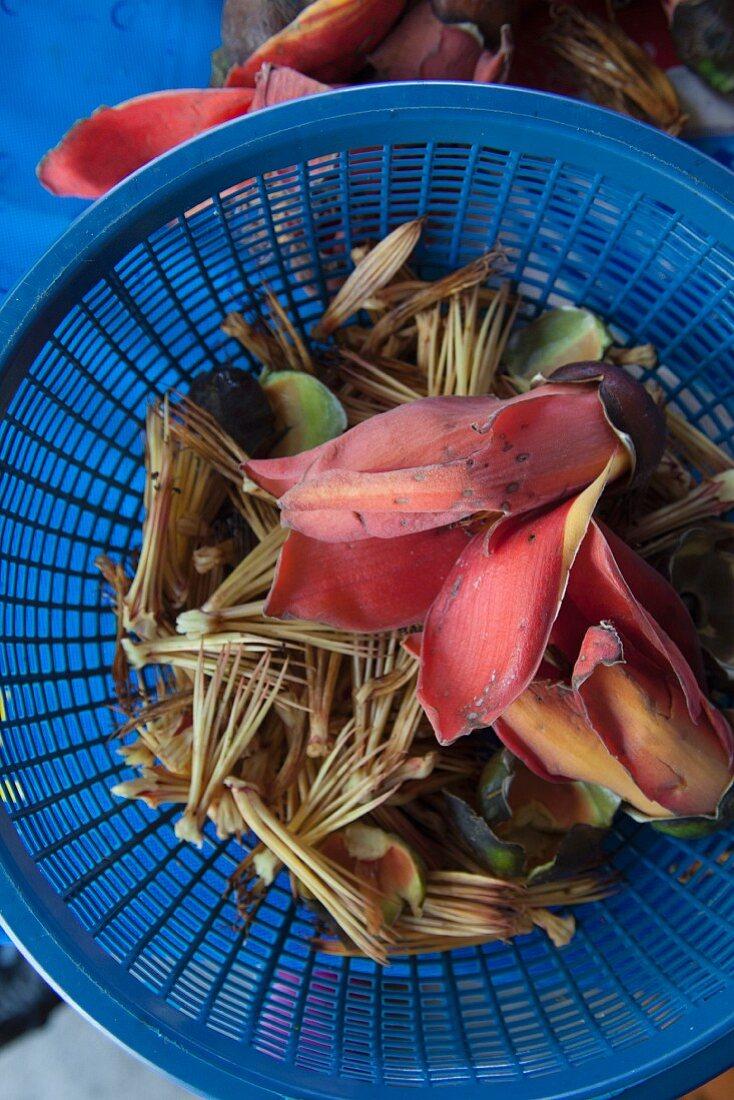 Bombak (edible flower, Thailand) in a plastic basket
