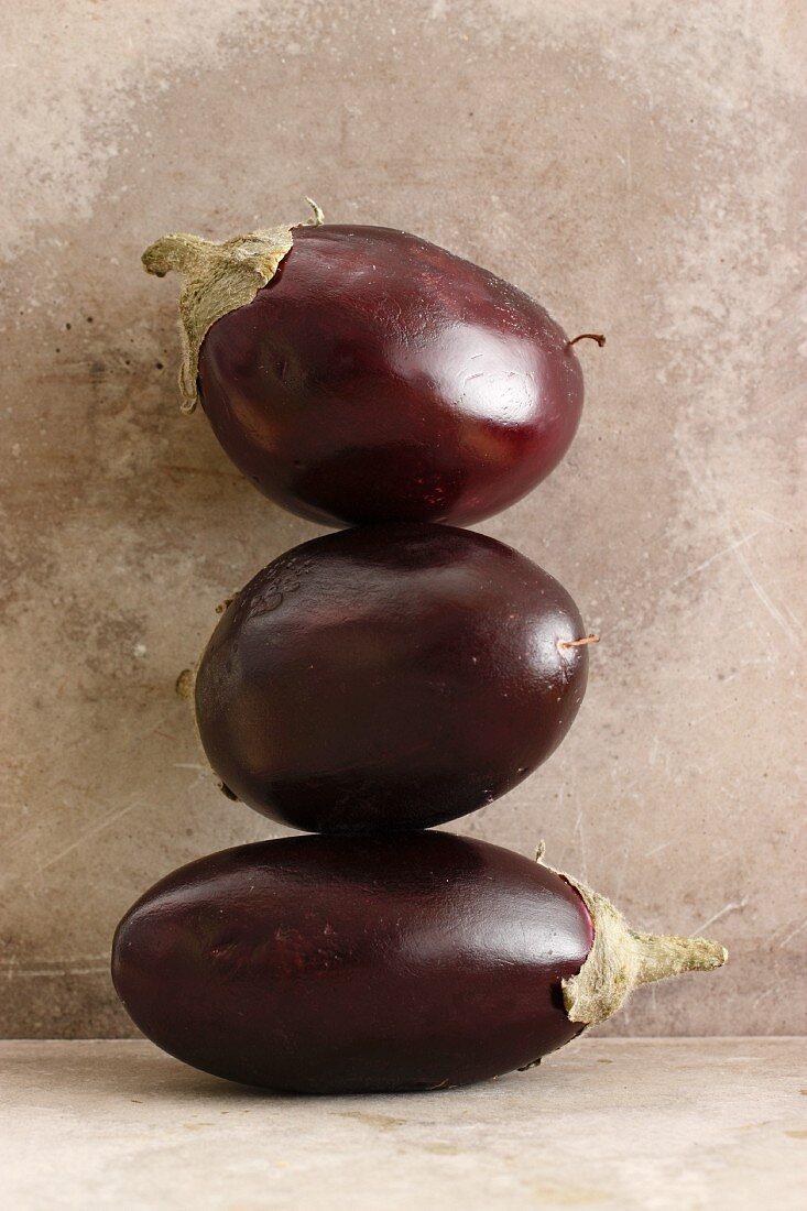 Three mini aubergines