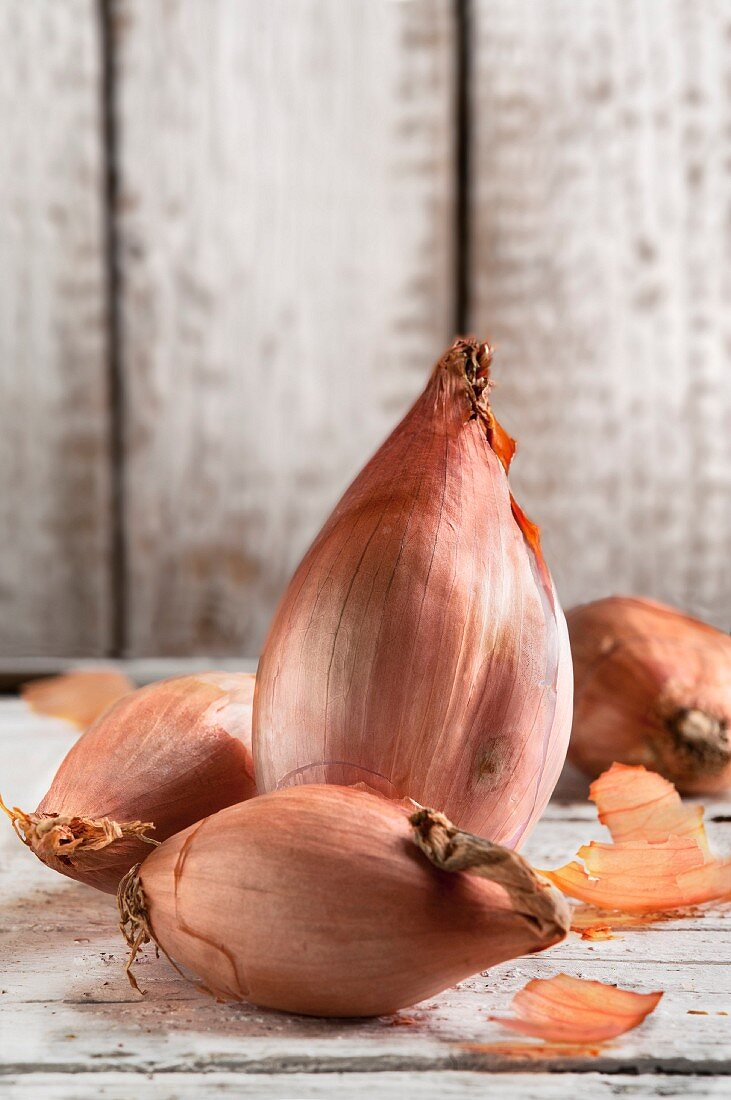 Shallots on a wooden table