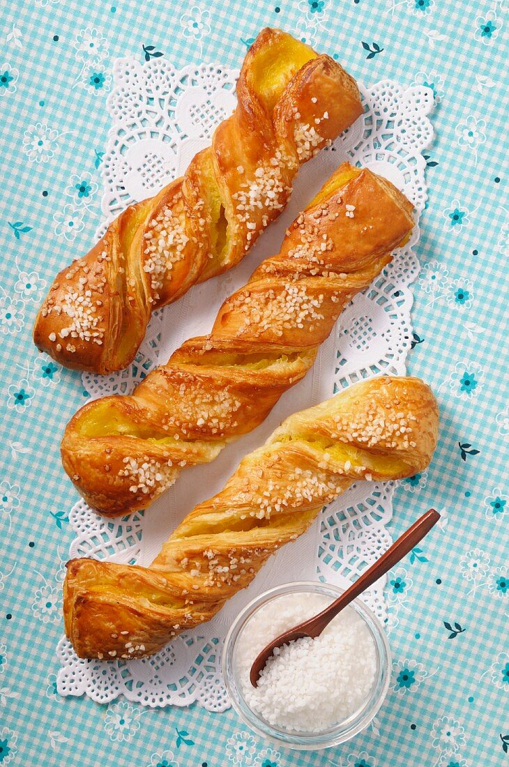 Puff pastry twists with sugar and vanilla cream