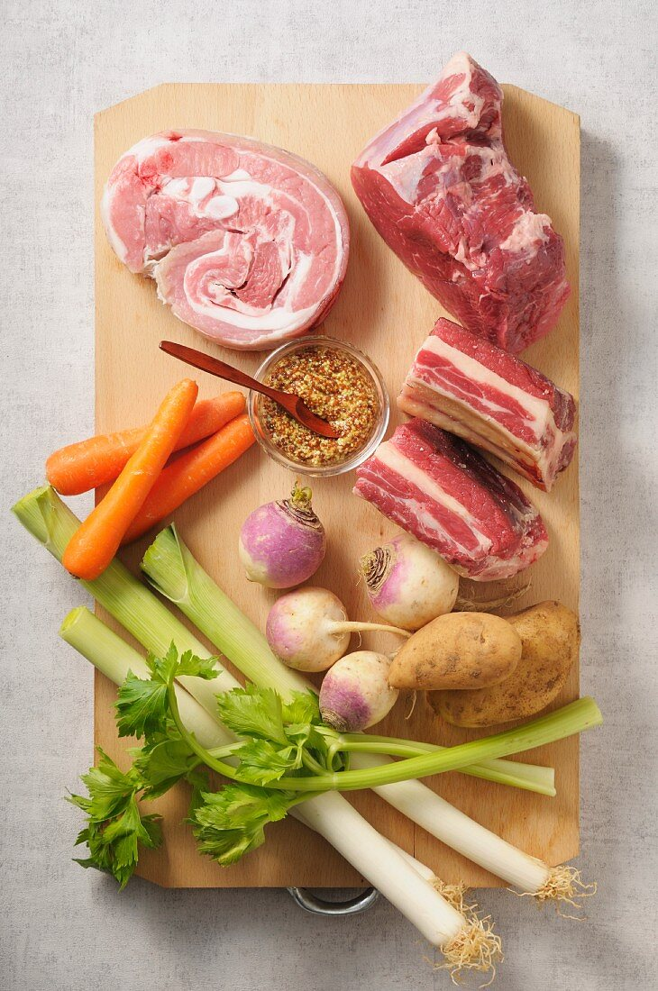 Ingredients for pot au feu on a chopping board