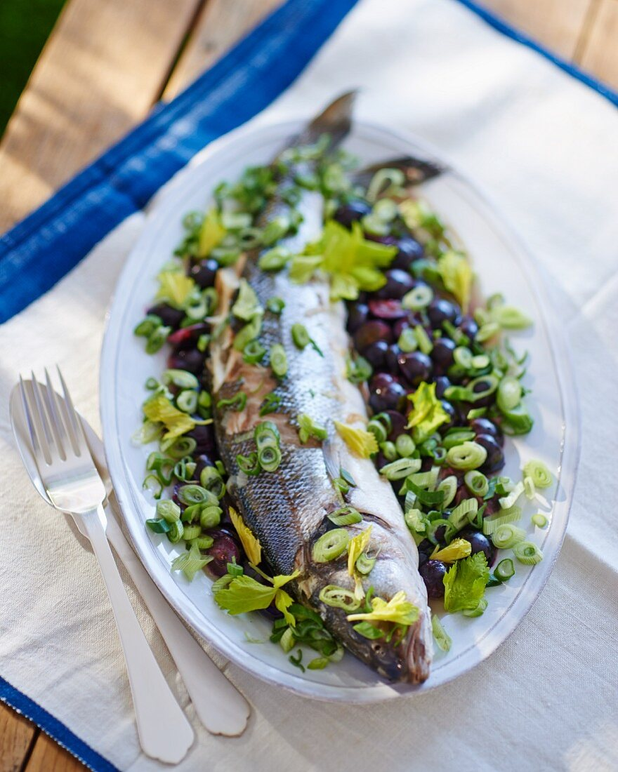 Sea bass on a celery and onion salad with black olives