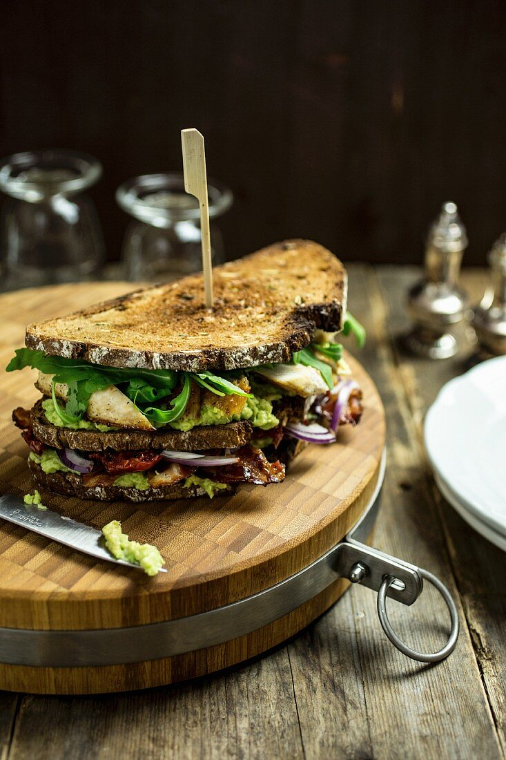 A BLT sandwich with chicken and avocado