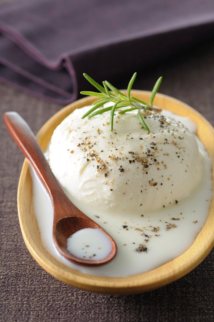 Fresh buffalo mozzarella with pepper and rosemary