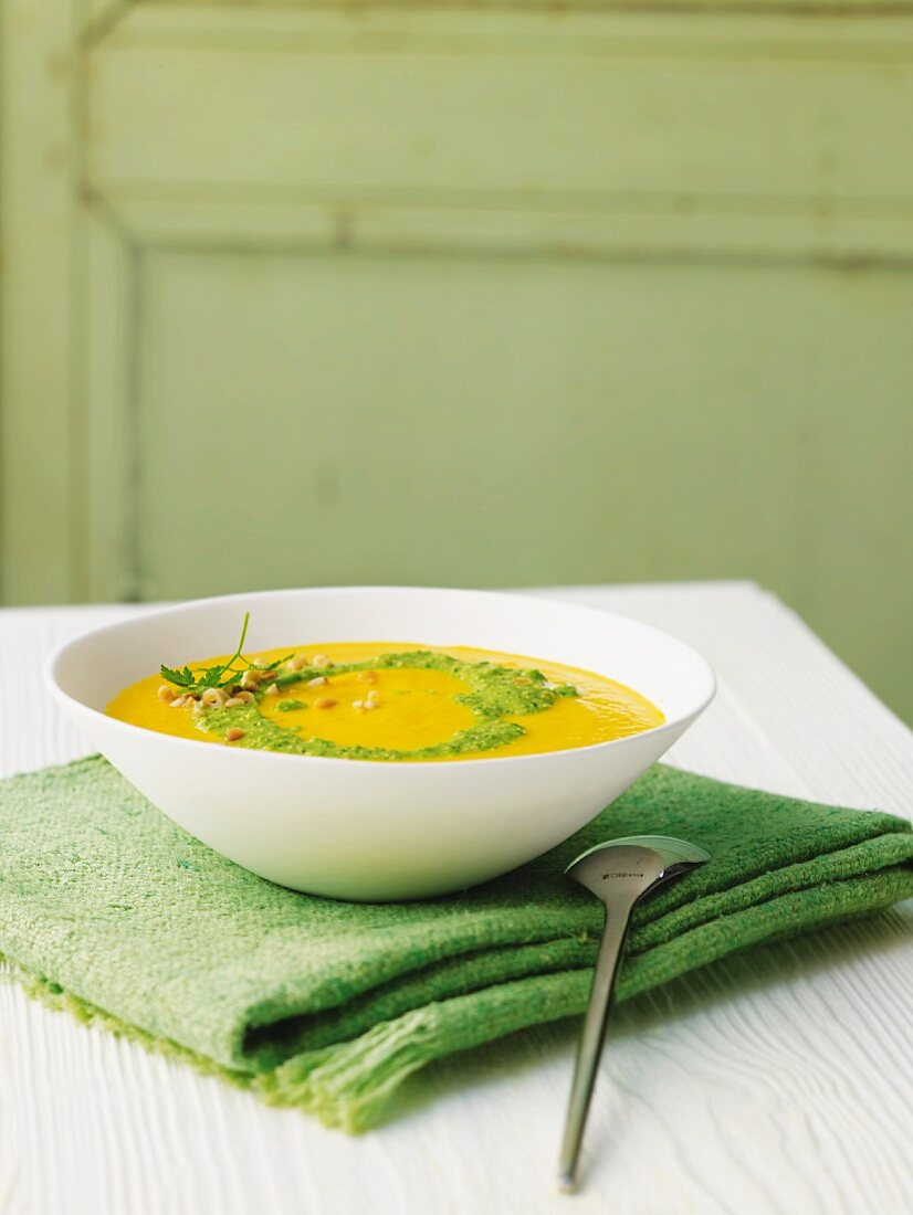 Carrot soup with pea and chervil pesto