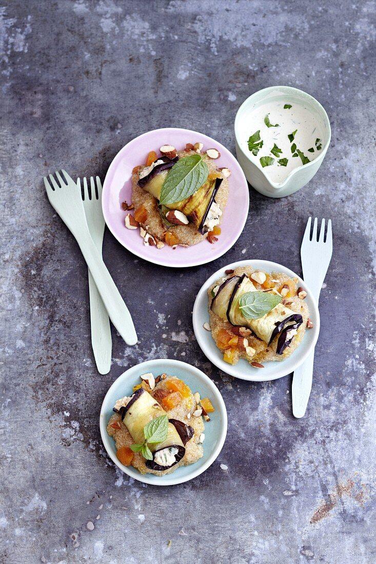 Aubergine rolls with almonds, mint and yogurt sauce