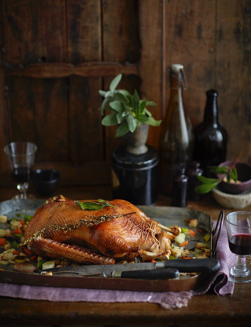 Crispy roast goose with a pear and bread stuffing