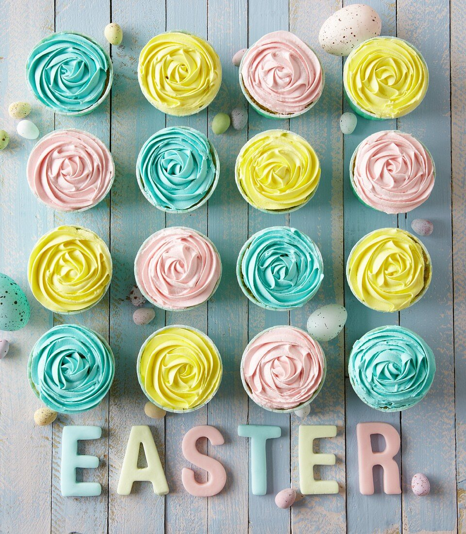 Cupcakes with pastel-coloured frosting for an Easter party