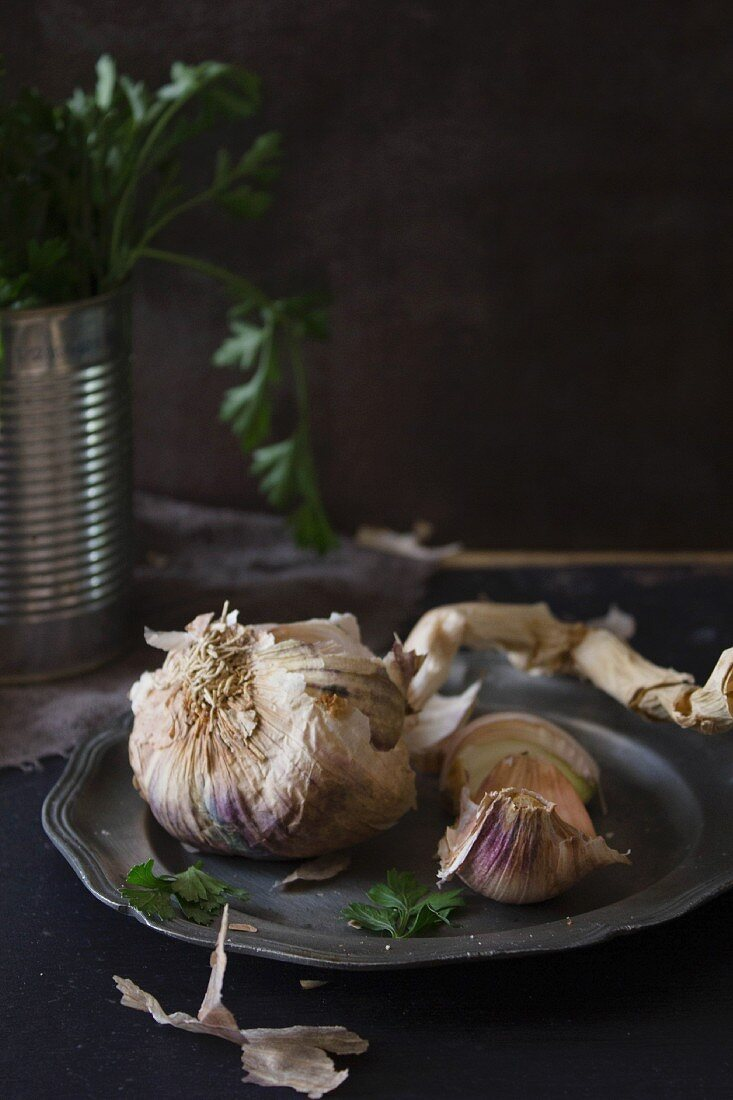 Dried garlic on a pewter plate