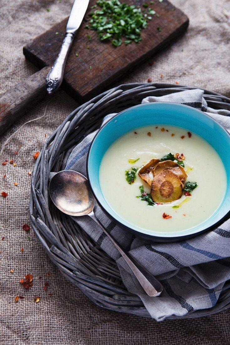 Cream of parsnip soup with crispy parsnip crisps