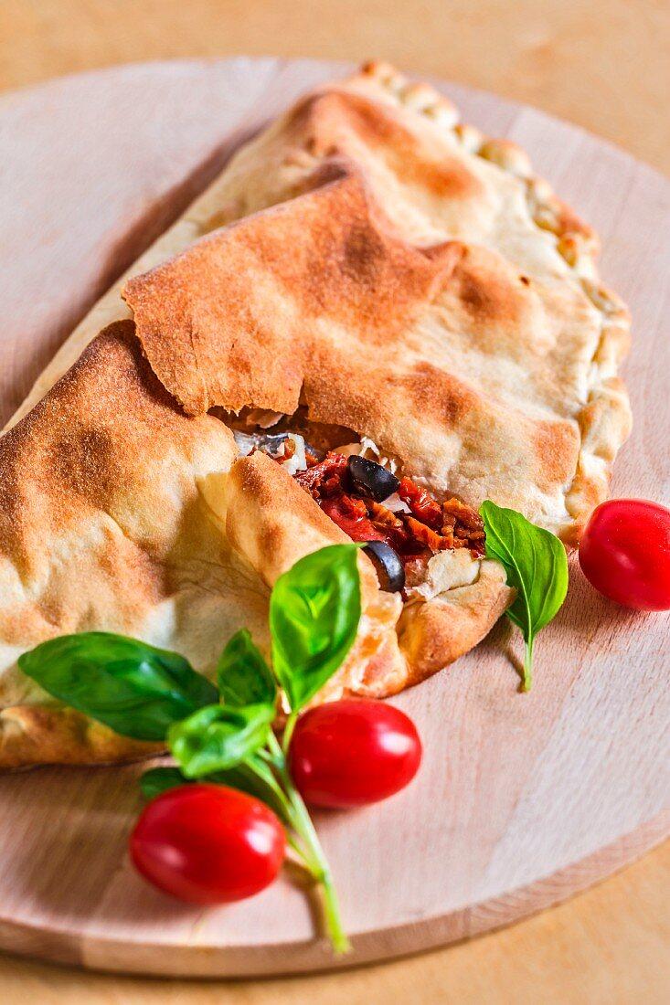 Calzone caprese (pizza pocket with tomatoes and mozzarella, Italy)