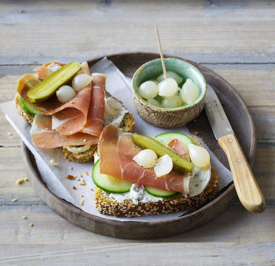 Open ham sandwiches with cucumber and pearl onions