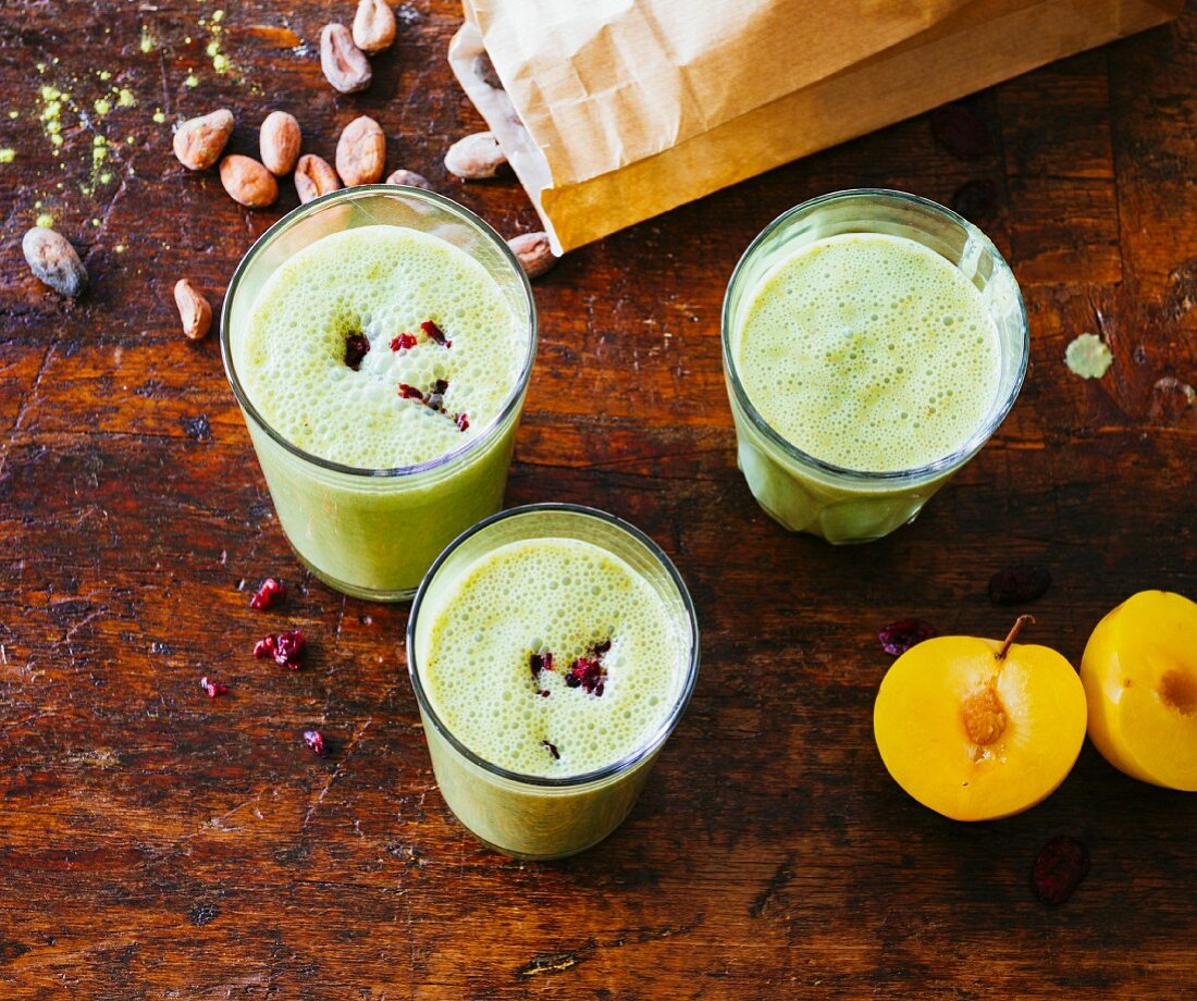 Cranberry and plum smoothies with cocoa beans, almond purée and stinging nettles