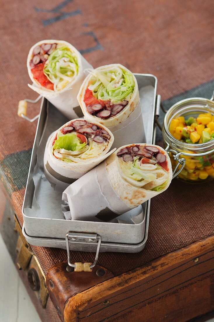 Vegetarian tortilla wraps filled with beans, lettuce and cheese