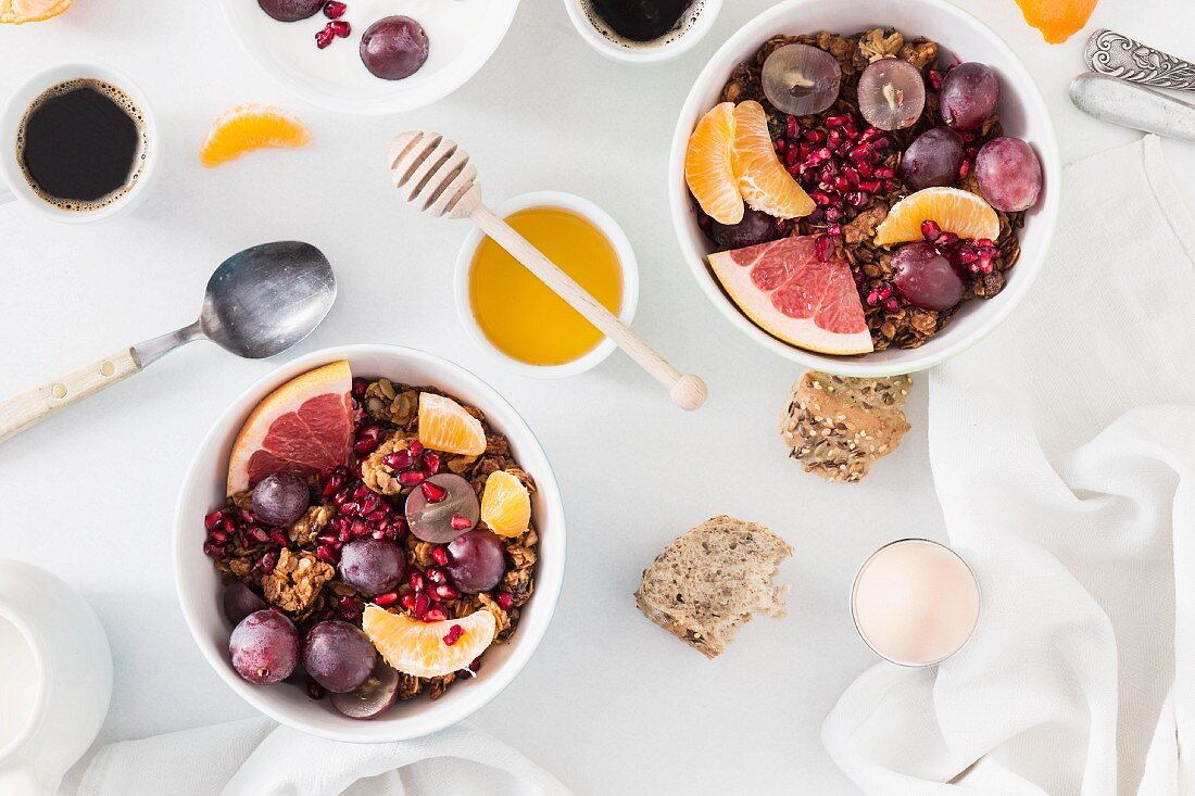 Breakfast with muesli, fruit, honey, eggs and coffee
