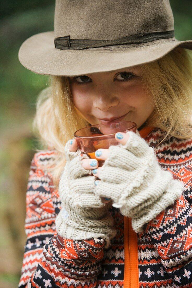 Blonde girl drinking spiced tea