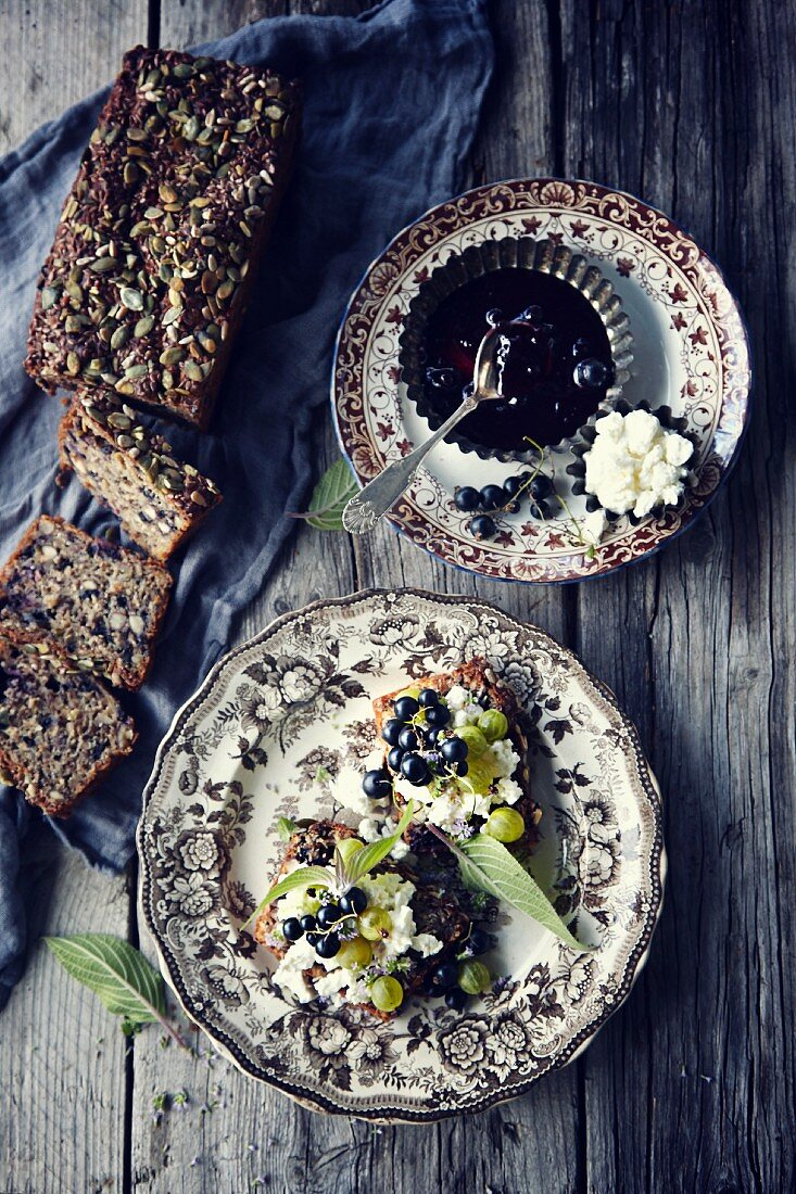 Nut and redcurrant bread with cottage cheese, berries and pineapple sage