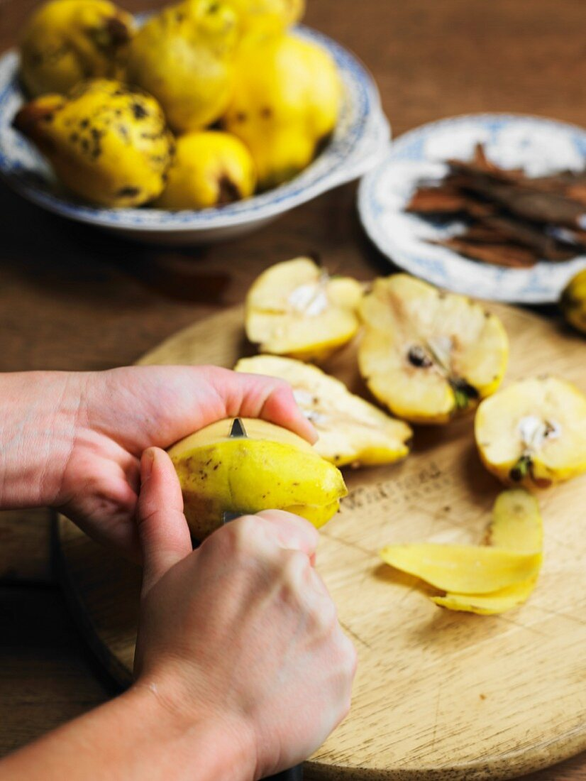 Quinces being halved and peeled