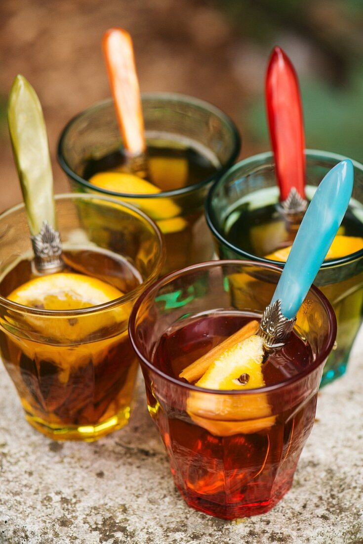 Spiced tea with lemons and cinnamon sticks