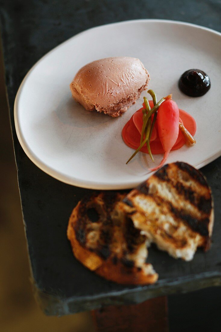 Chicken liver parfait with foie gras, plums and radishes at the 'Nomad' restaurant, Sydney