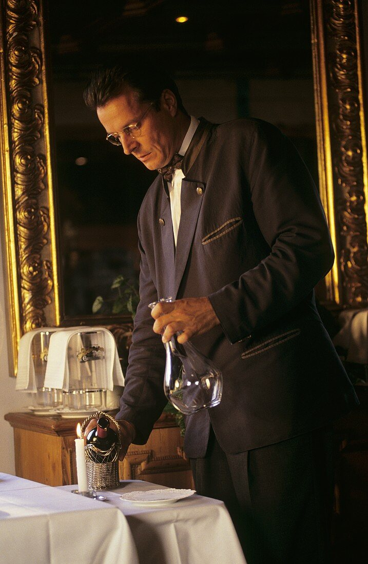 "Wine waiter decanting wine in ""Kurhausstüberl"" (Waging am See)"