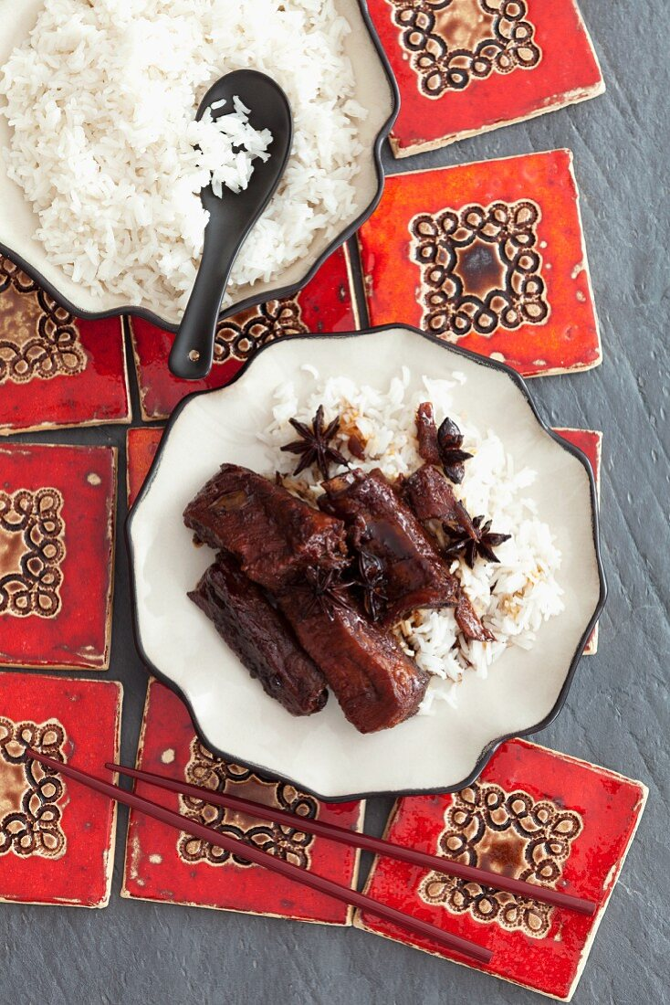 Braised ribs with anise, soya sauce and honey with a side of rice (Asia)