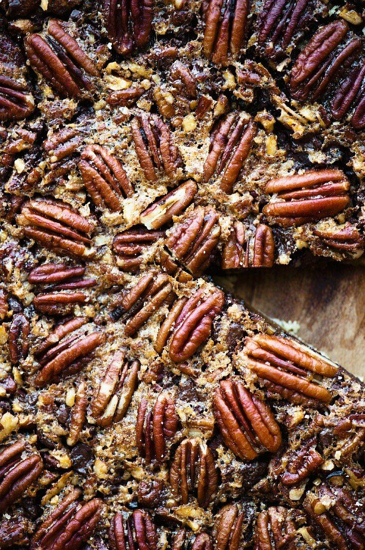 A pecan nut tart, sliced (seen from above)