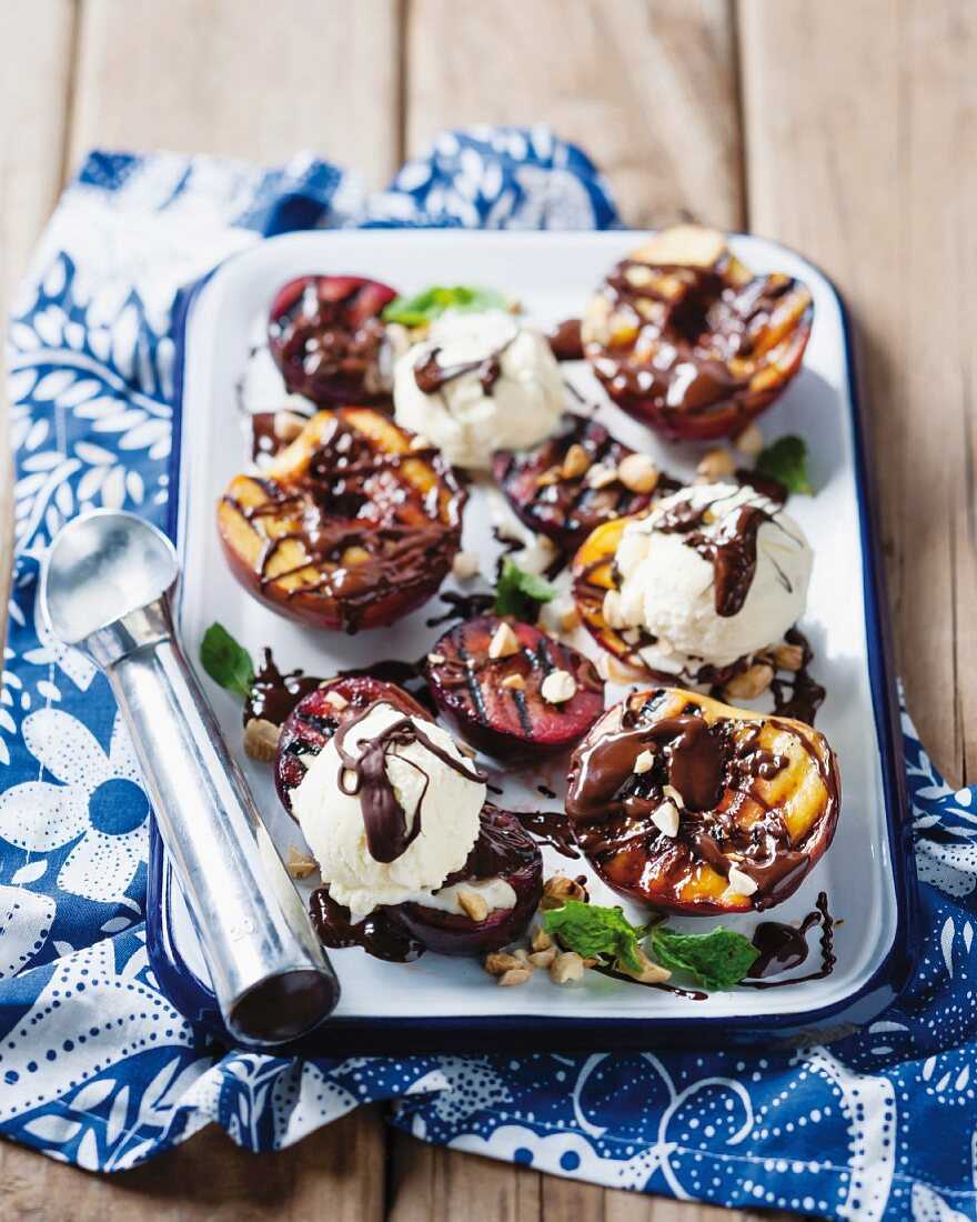 Grilled fruit with vanilla ice cream and chocolate sauce