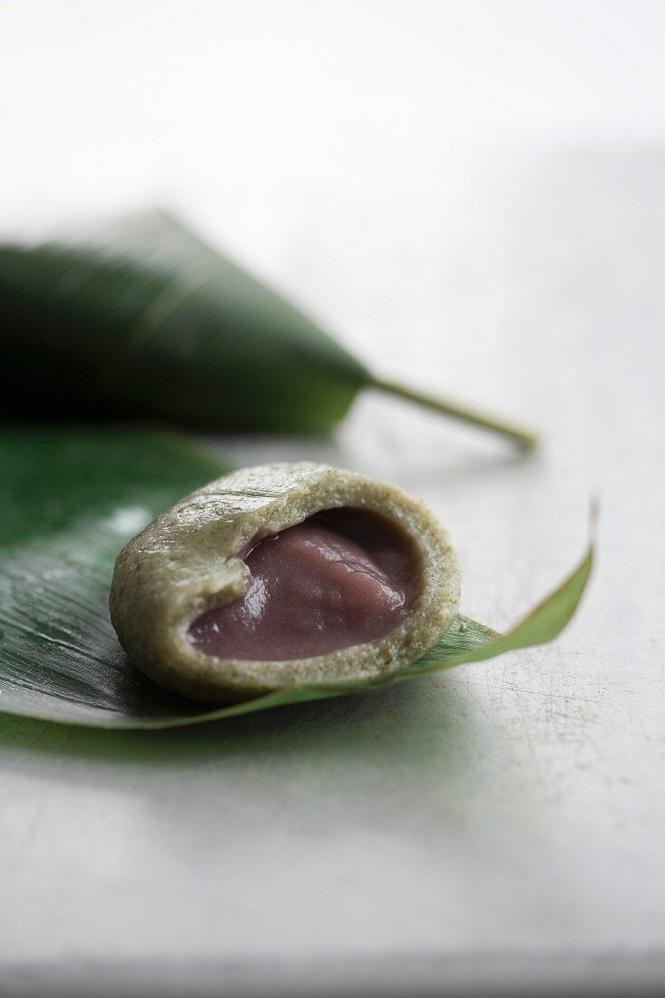Green tea wagashi wrapped in a bamboo leaf (typical summer mochi from Japan)