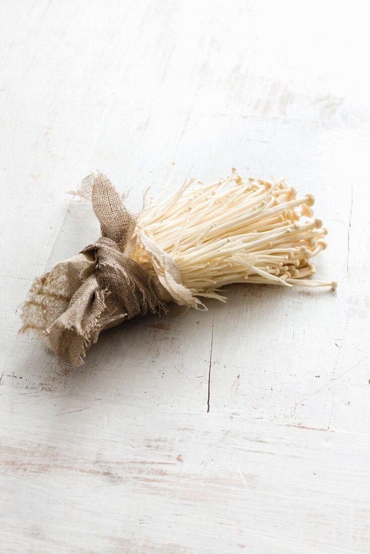 A bundle of fresh enoki mushrooms