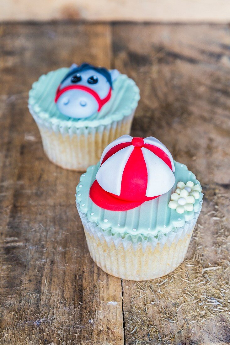 Cupcakes decorated with horse riding motifs