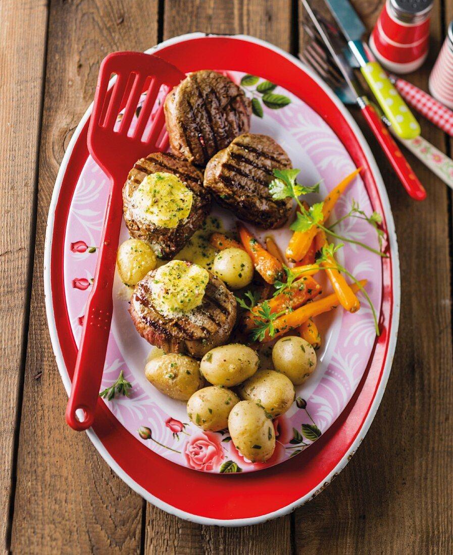 Fillet café de Paris with new potatoes and a carrot medley