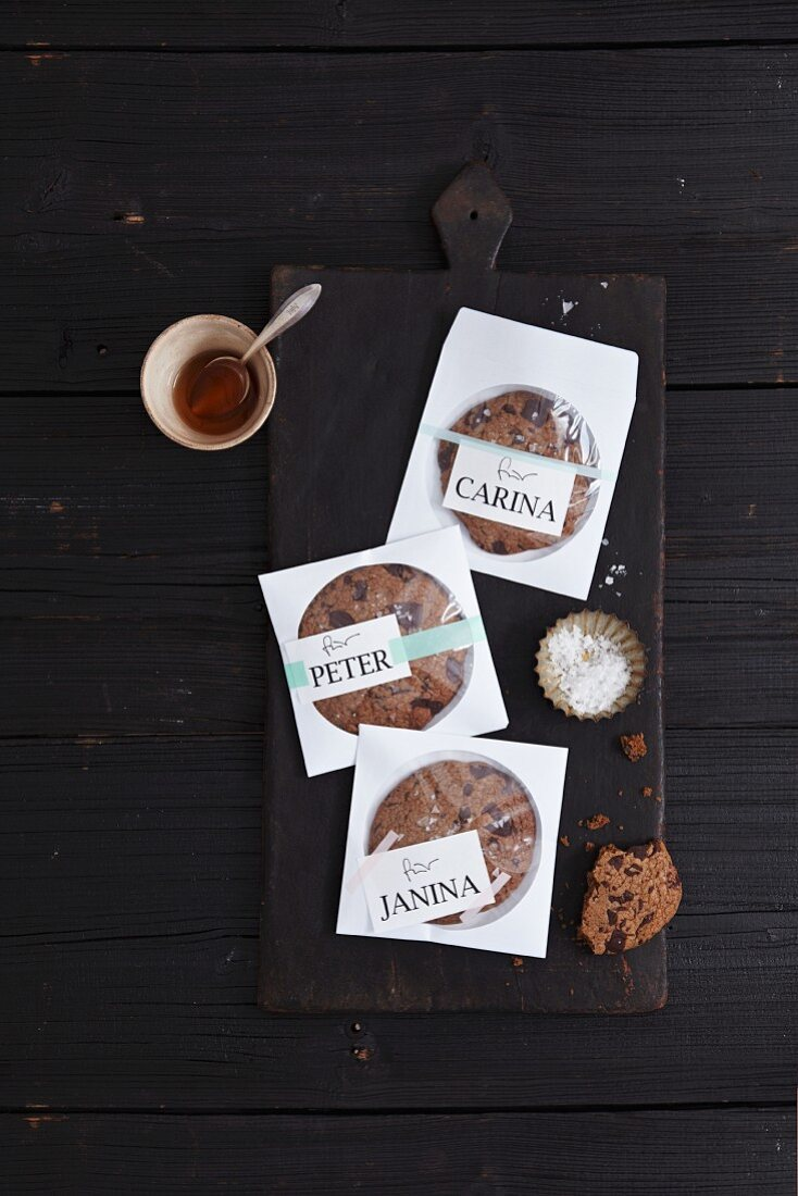 Chocolate chip cookies as a gift packaged in labelled paper CD covers