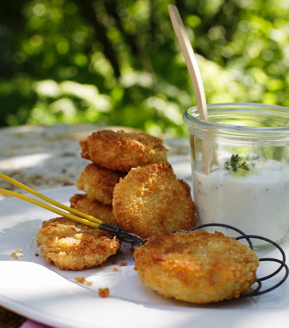 Breaded kohlrabi slices with cress yoghurt
